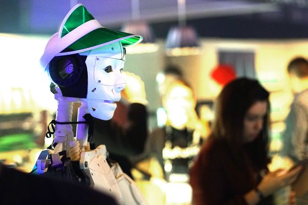 Futurice's social research robot working as a blackjack croupier at Slush