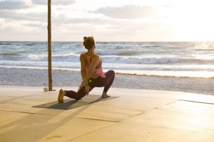 breathing and stretching by ocean