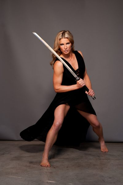 Heidi Moneymaker with a sword in a dress