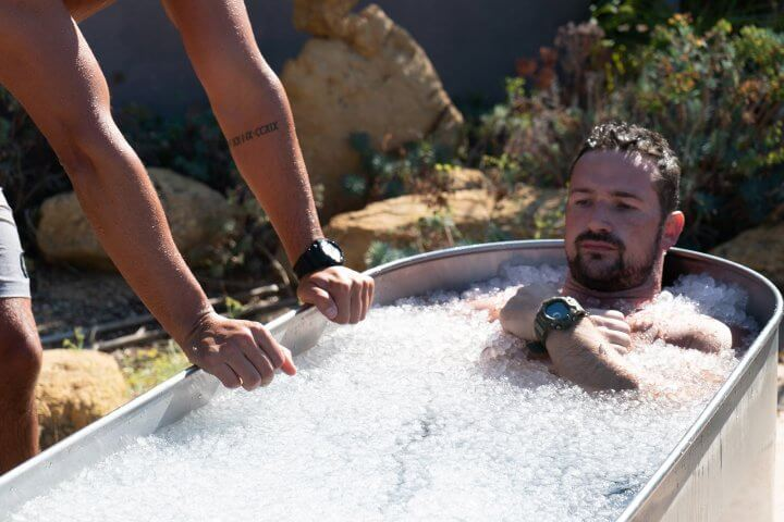 In an ice bath outdoors