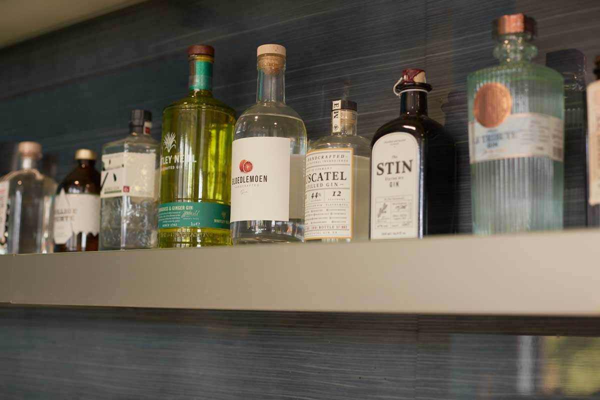 We keep our office bar stocked with at least thirty varieties of gin.