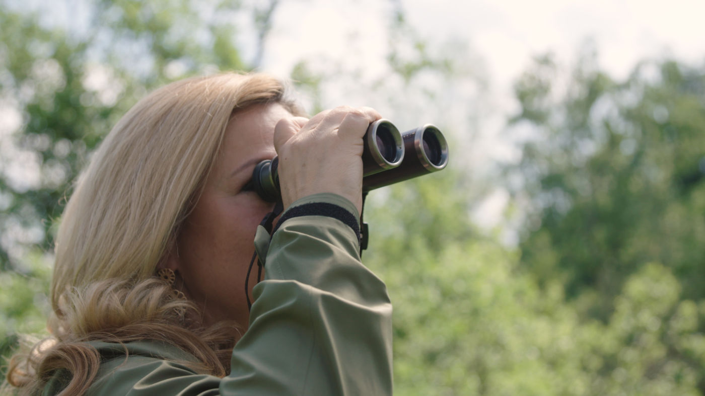 CL Companion Nomad Purpose Carina Schiestl-Swarovski looking through binocular