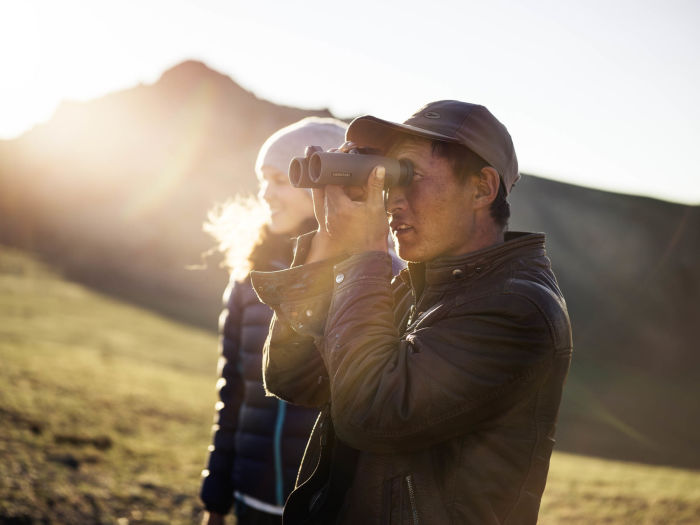 Swarovski Optik Surprises along the Silk Road Nature Outdoor portrait of two people and a binocular