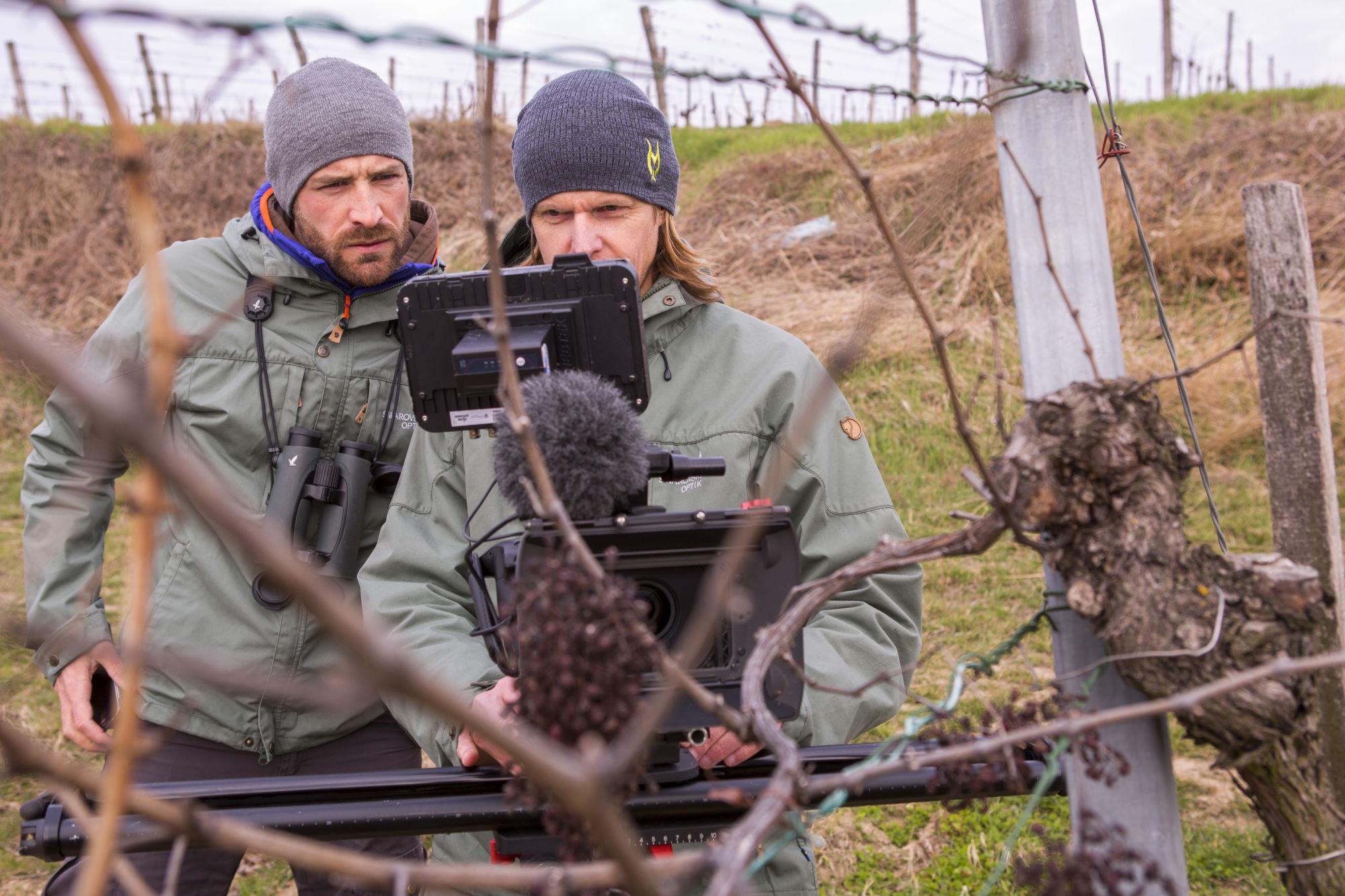 "Mario Kreuzer and Leander Khil digiscoping video footage for their documentary ""Kestrels don't read scripts"" near Vienna, Austria."