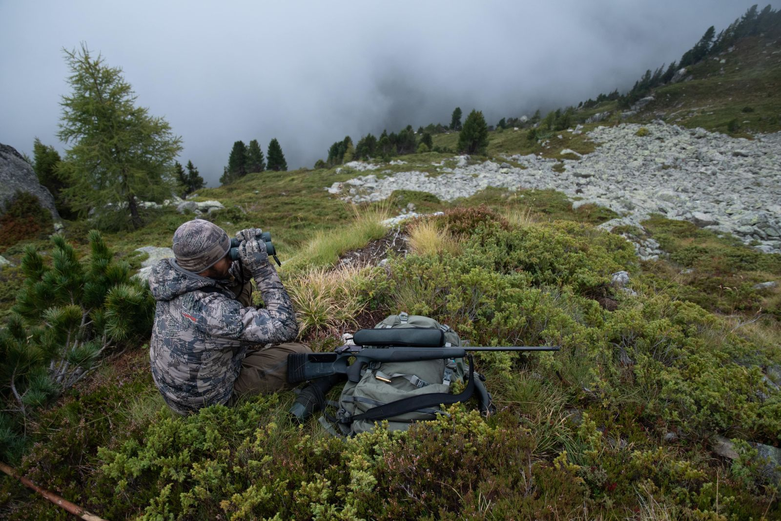 Hunting chamois with the EL Range TA in the Swiss Alps, hunter binoculars and backpack
