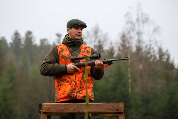 Join  us on a driven hunt in Belgium H/ - Dimitri Hullebroek on his stand holding the Z8i 2-16x50 P SR