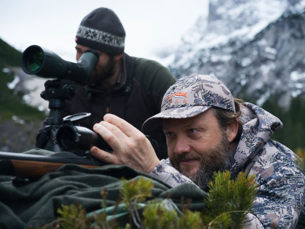 Nikolaj Juel rocks cooking, music, and hunting - two men hunting in the mountains using the SWAROVSKI OPTIK ATX spotting scope and Z8i rifle scope