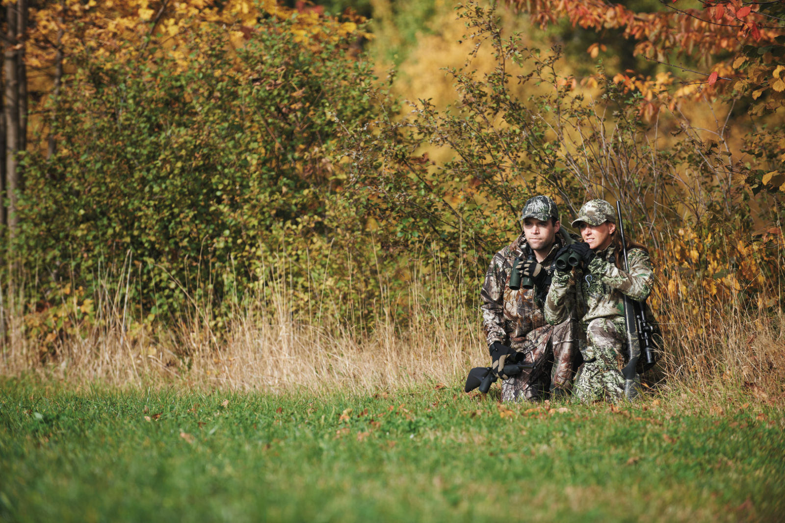 SLC, two hunters sitting on the ground in camo outfit
