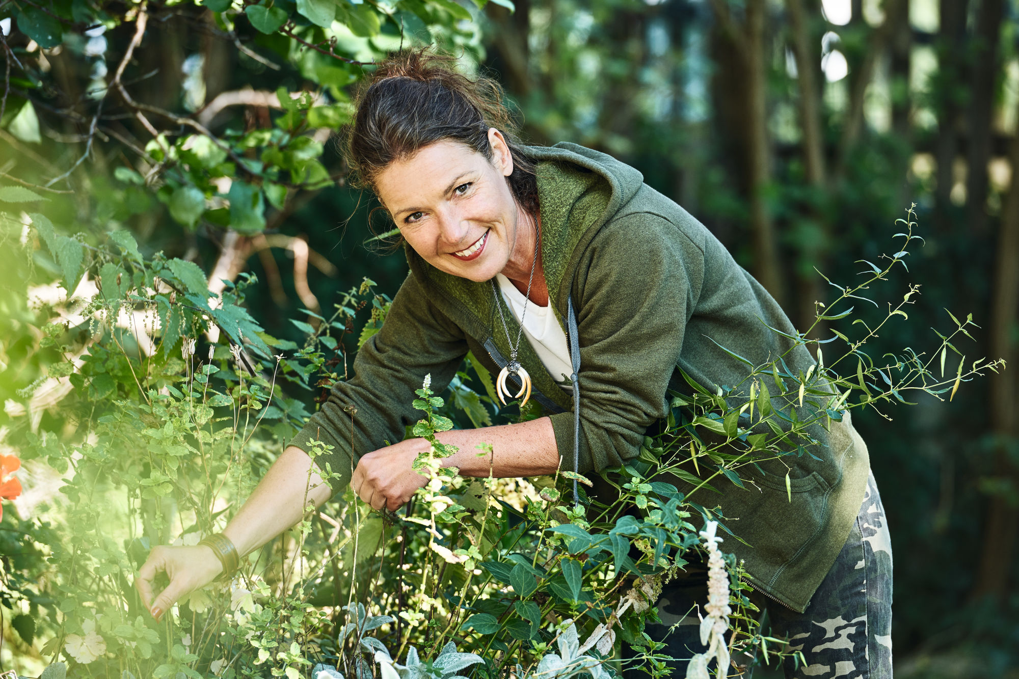 Hunting can heal Barbara Hoflache picking herbs