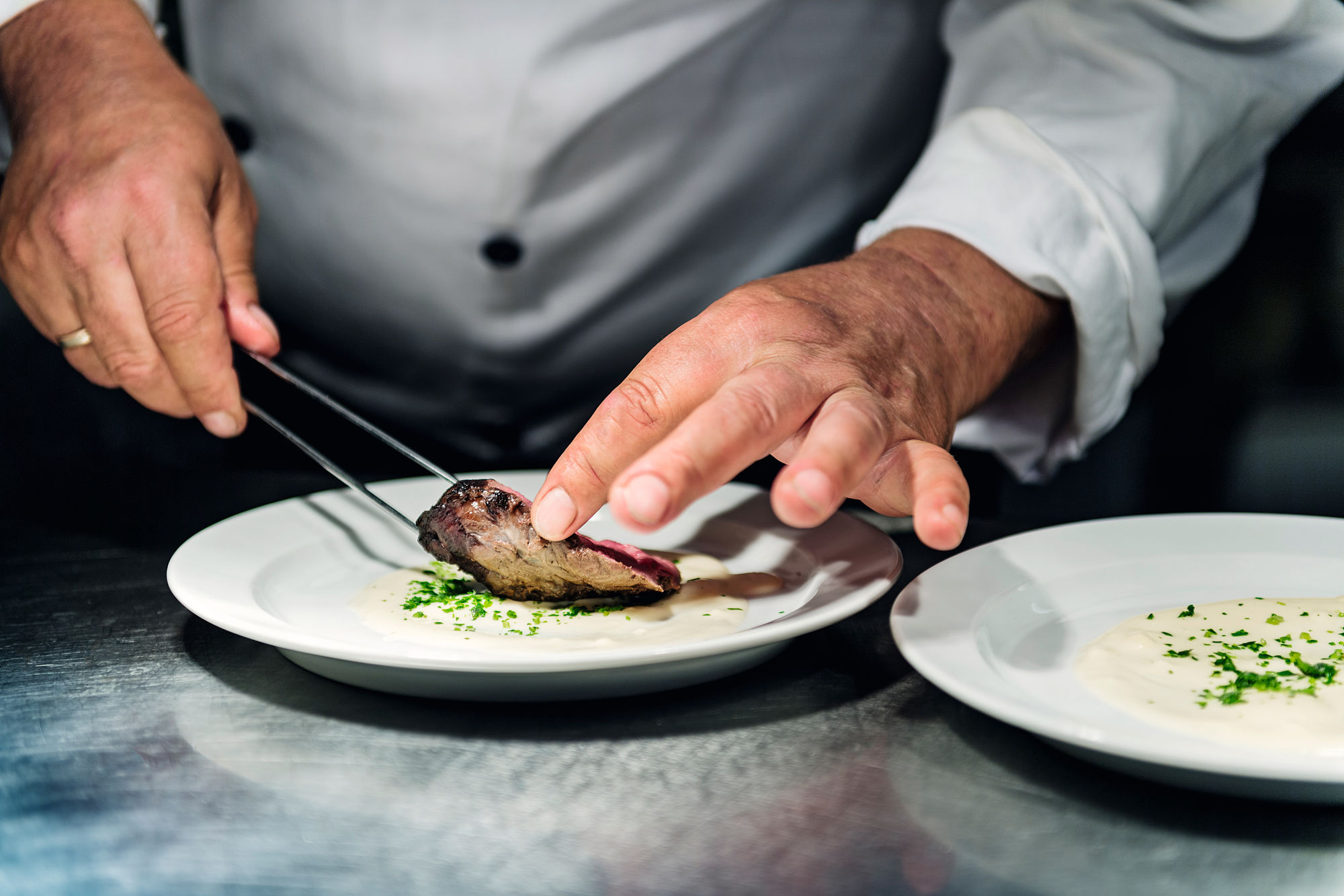Swarovski Optik APPRECIATING THE GIFTS OF NATURE Robert Niederkofler preparing dish. from the wild to the table