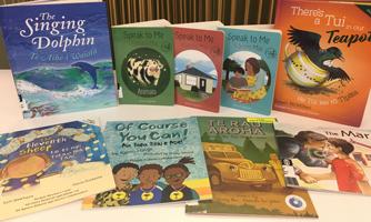 Te reo Māori and English bilingual books displayed on a table
