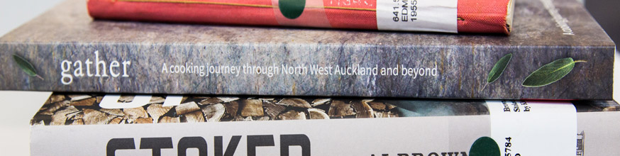 PIle of books, spines read gather, 'A cooking journey through North West Auckland and beyond' and 'Stoked'.