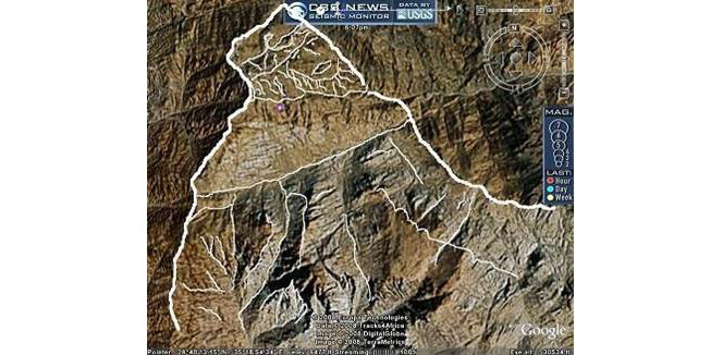 Satellite image of mountainous terrain, overlaid in white MS paint lines to 'reveal' an image of a man with a beard, and possibly some sort of hat.