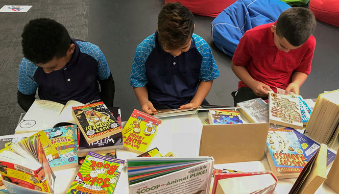 Boys selecting books to read.