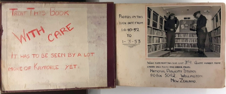 First two pages of the photo album with handwritten messages in red and black ink including a black and white photo.