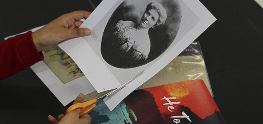 Person cutting out a portrait of Kate Sheppard.