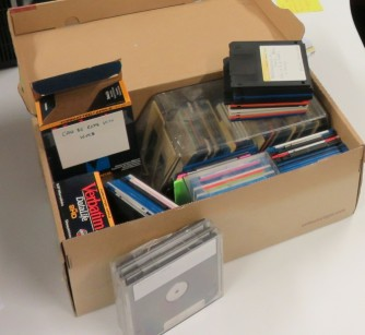 A shoebox full of floppy disks containing literary drafts.
