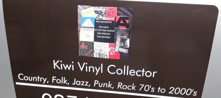 Car sign soliciting offers to buy vinyl records.
