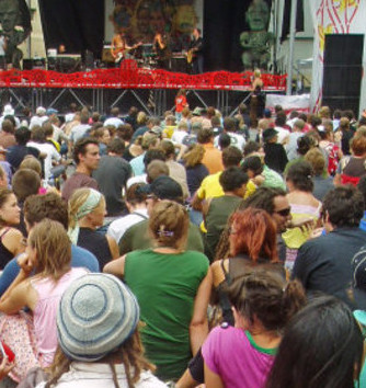 Crowd sitting in front of the stage at Cuba Street Carnival.