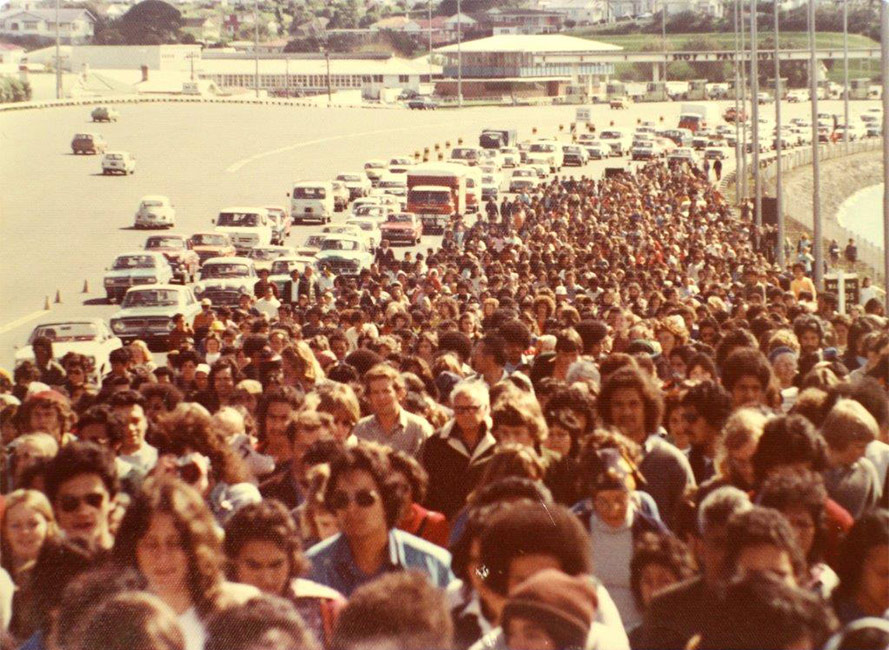 People protesting in the Māori Land March close lanes to traffic as they cross Auckland Harbour Bridge, 1975.  [1975 hīkoi](/files/schools/hm60-1975-hikoi-english.mp3)