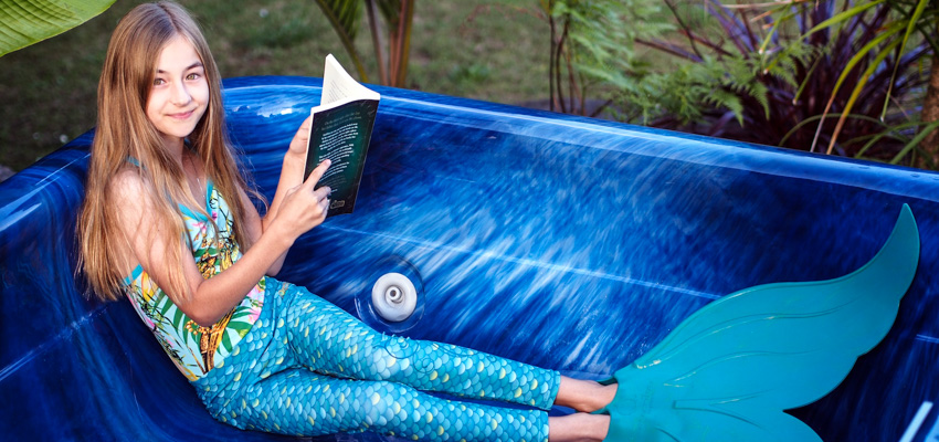 Student reading in an empty spa pool.
