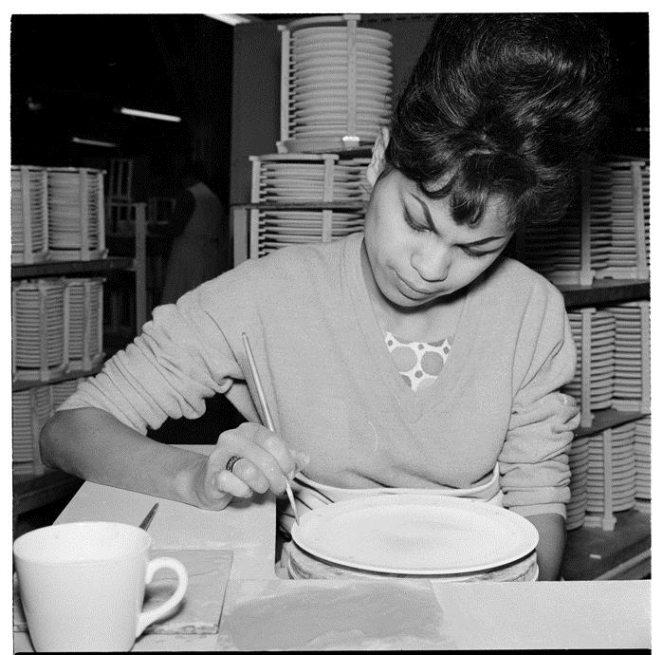 Worker applying a design to a dinner plate at Crown Lynn Potteries, Auckland, 1963, taken by Ans Westra (Reference: AWM-0522-06). No further use, including on websites, without permission of the copyright holder.