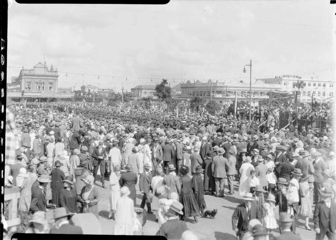 Photograph of a crowd during the visit by the Duke and Duchess of York.