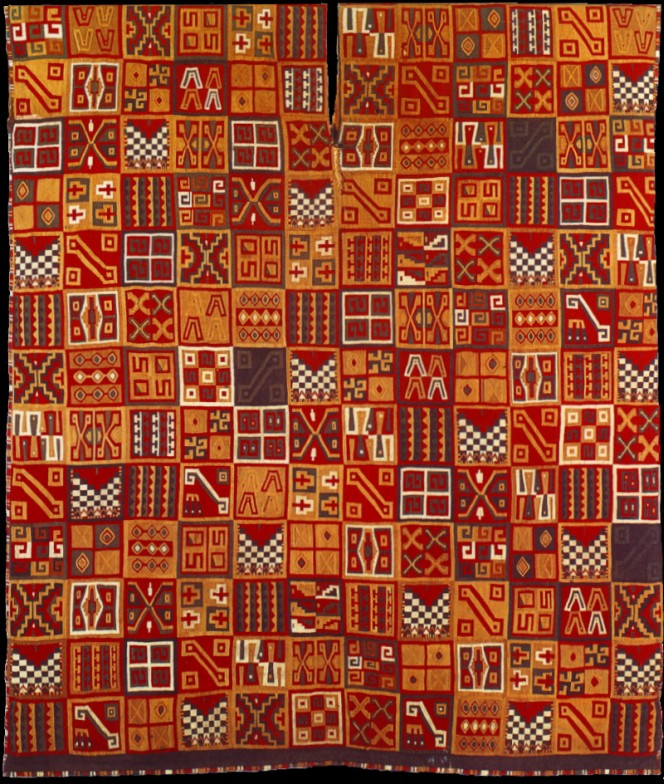 An Incan royal tunic, heavily patterned, substantially shades of orange and red.