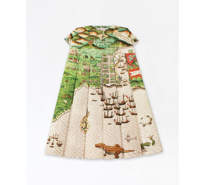 Dress patterned with a medieval map, highlighting a fleet of ships and a alligator-ish creature.