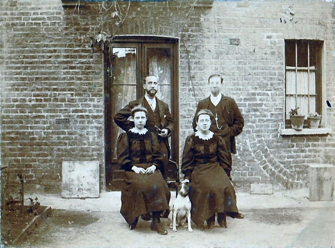 William, Harry, Dolly, Spot and Bessie photographed in the yard beside their house in St Augustine's Road.