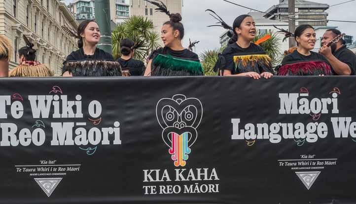 People marching with banner in Te Wiki o te Reo Maori parade in Wellington