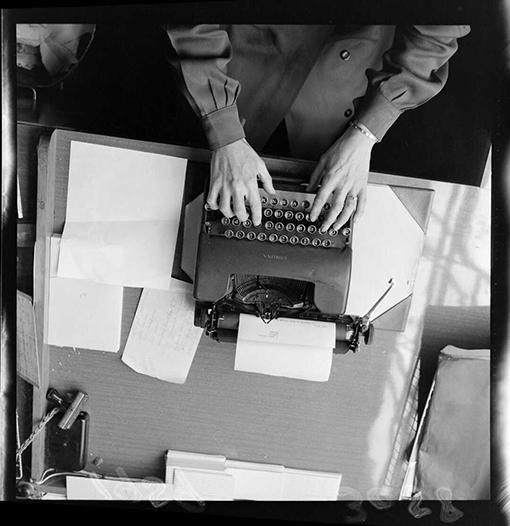 Someone using a typewriter