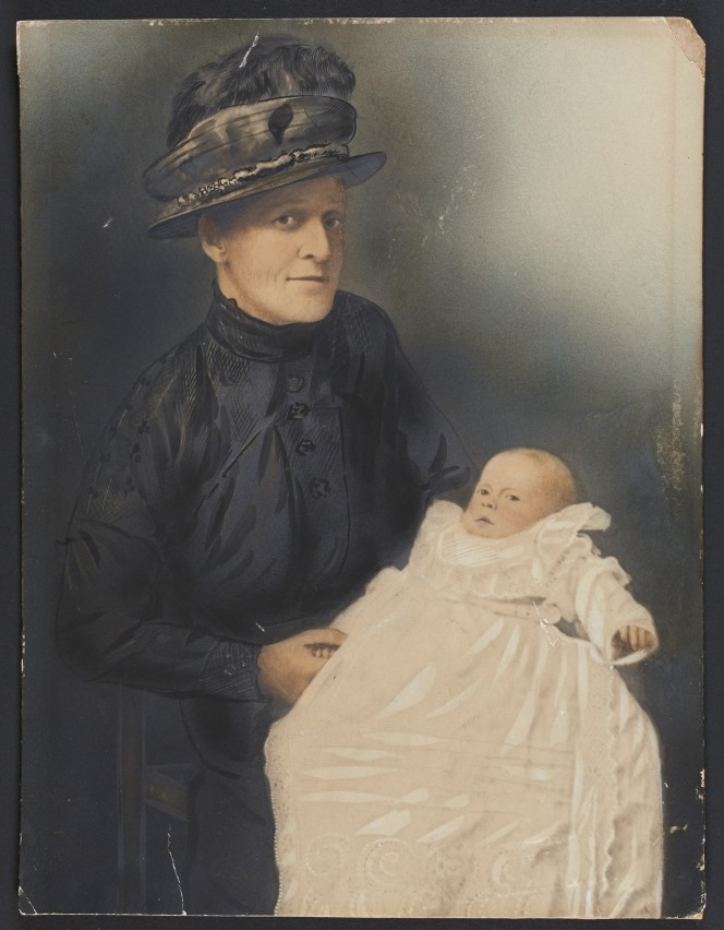 Hand coloured version of the previous image of a woman and baby.
