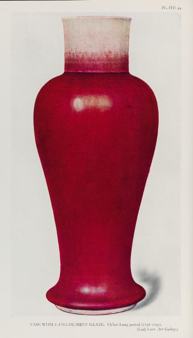 A red glazed vase.