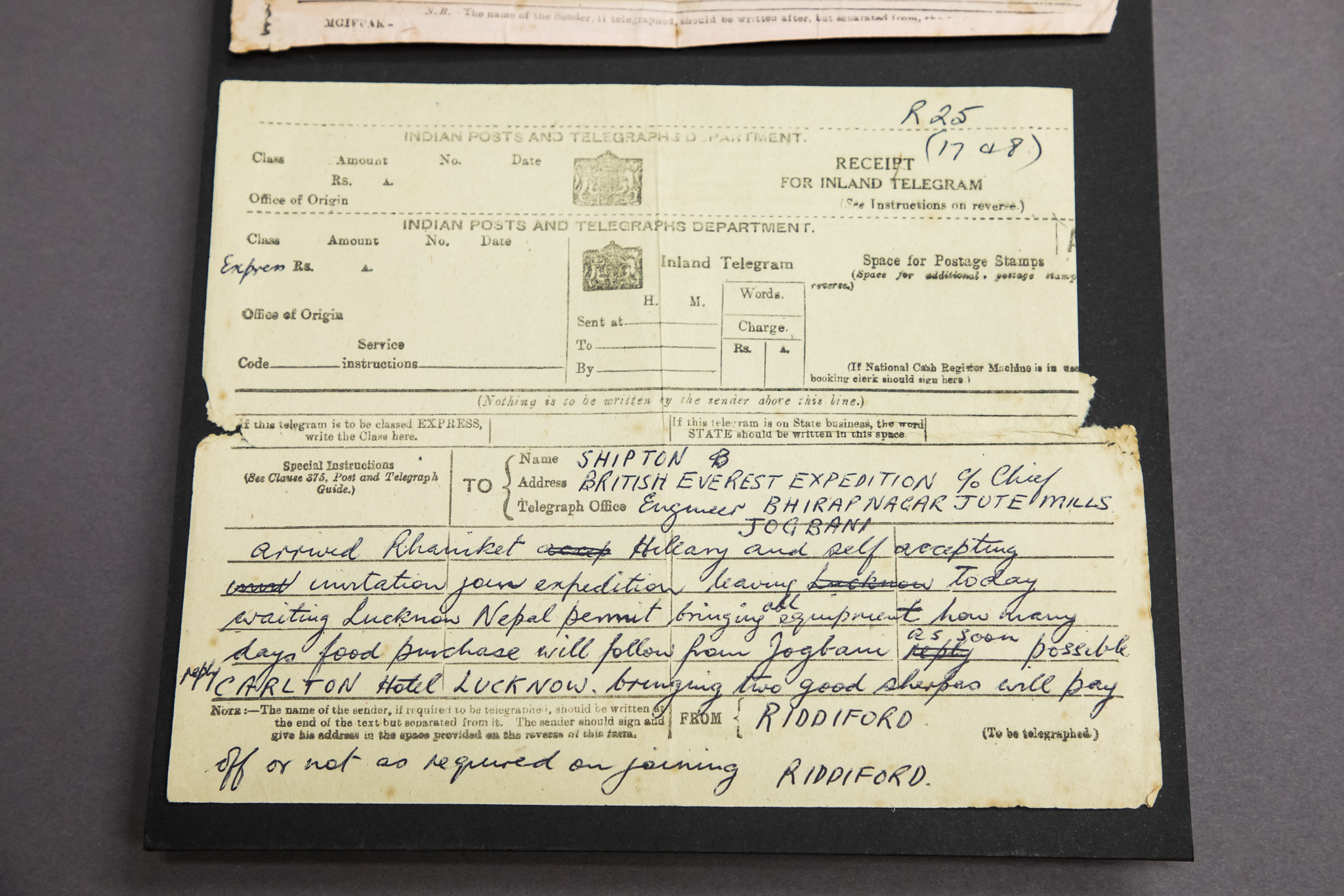 A telegram with a handwritten message.