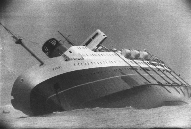 Ship Wahine sinking in Wellington Harbour, 11 April 1968. Shows the port side.
