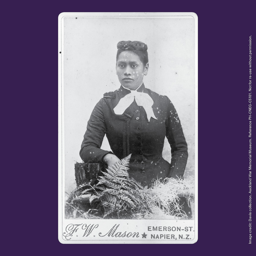 Front of curiosity card CC0010, with a portrait image of Meri Te Tai Mangakāhia seated with plants. The words 'F W Mason Emerson Street Napier NZ