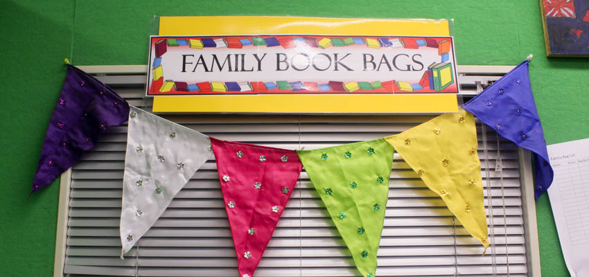Coloured flags under a sign with the words'family book bags.