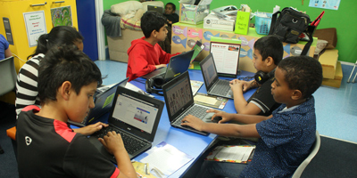 Students using laptops in the classroom