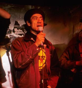 Charlie Tumahai as Karaoke Man singing in a bar.
