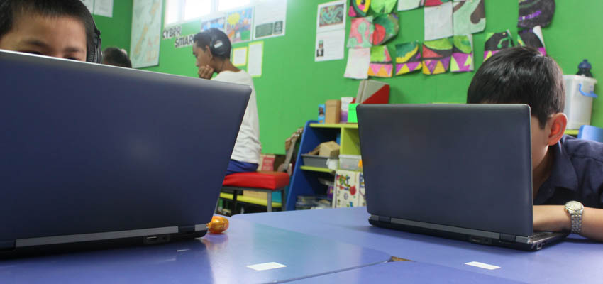 Students using their laptops.