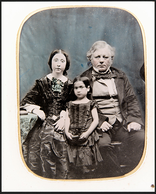 William Barnard Rhodes with his wife Sarah and daughter Mary Ann. When Mary Ann's Māori mother died, she was taken to her father and raised by him. When her father died Mary Ann became the wealthiest woman in Aotearoa New Zealand.  [William Barnard Rhodes](/files/schools/hm14-rhodes-family-english.mp3)