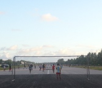 After work football on a runway.