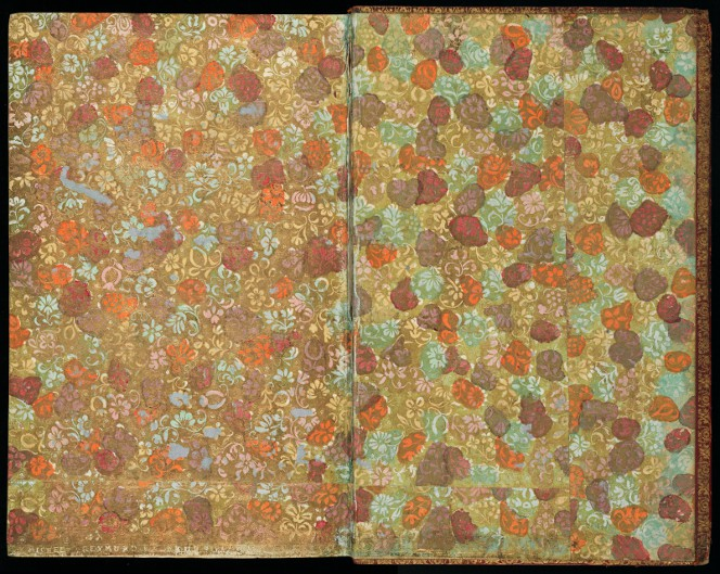 Gilt paper with an intricate floral pattern, coloured in blots of yellow, orange, green, and brown.