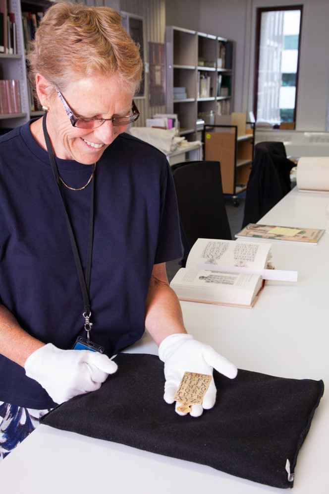 Curator of the Rare Book Collection, Ruth Lightbourne, with the newly-acquired hornbook in her hand.