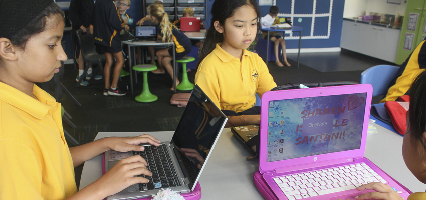 School children working with laptops in the classroom.