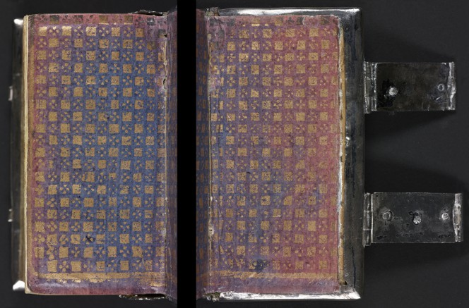Gilt, blue, and red endpaper on a silver-bound book.