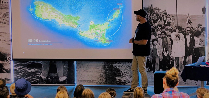 Senior Education Specialist (Culture and Heritage) presenting to school students about NZ history