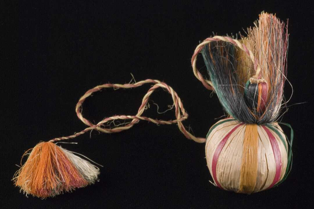 Poi with coloured stripes and long plaited, fringed tassel.