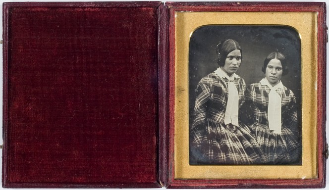 Daguerreotype image in its case, showing two sisters in mid-19th century clothing.